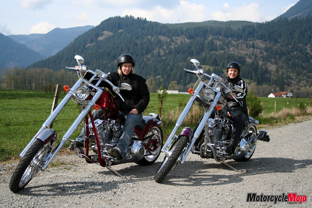 Two custom choppers along the side of the road