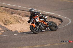 Riding a 2015 KTM Super Duke 1290R By a Sandy Highway